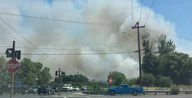 A large fire was burning Thursday near the town Escalon. See photos from LiveCopter3 and KCRA reporters and viewers.