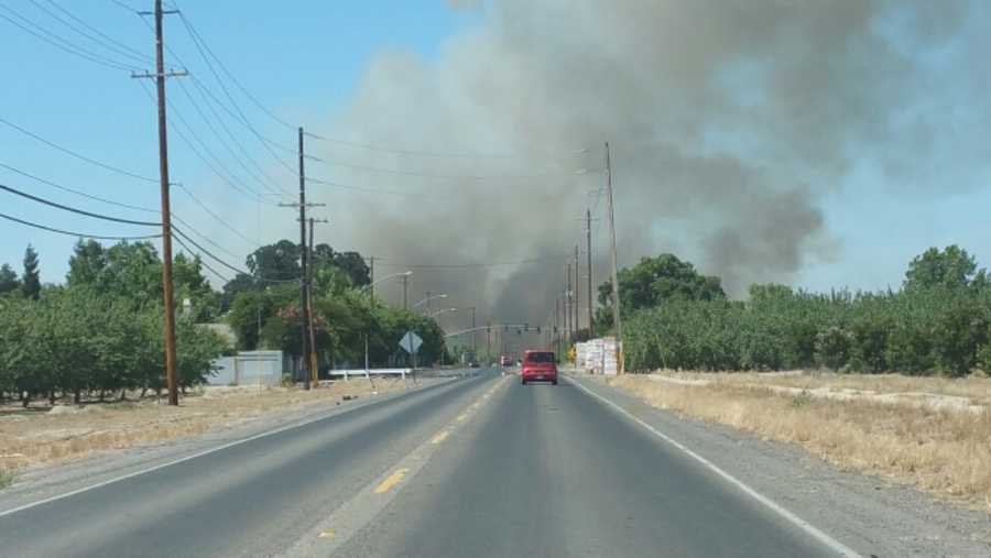 A large grass fire was burning south of Escalon in Stanislaus County. (June 18, 2015)