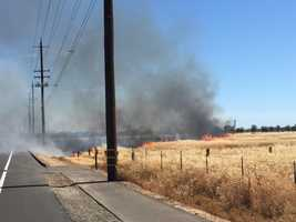Sacramento Metro Fire crews battle a grass fire in South Sacramento on Thursday. (June 18, 2015)