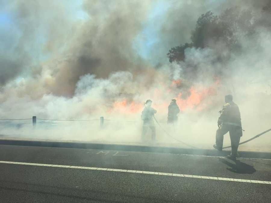 Sacramento Metro Fire crews battle a grass fire in South Sacramento on Thursday. (June 18, 2015)