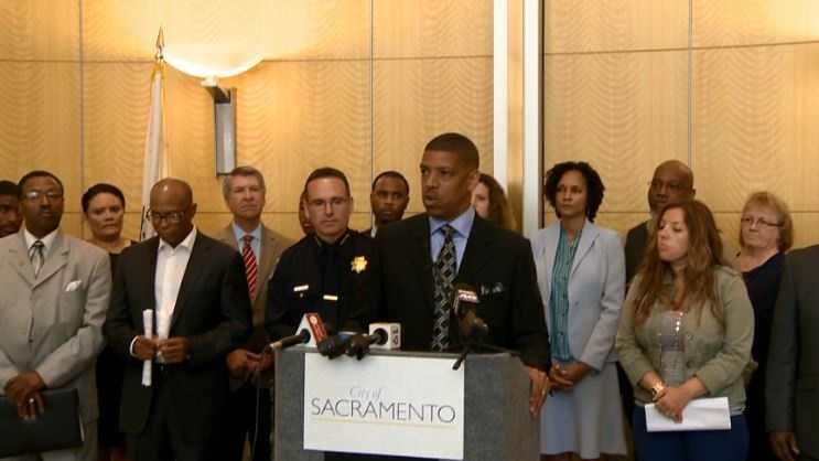 Sacramento Kevin Johnson reacts to the Charleston church shootings during a news conference on community police relations.