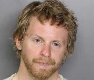 Timothy Brownell was arrested on charges on assault with a deadly weapon and is suspected in a hate crime, police said.