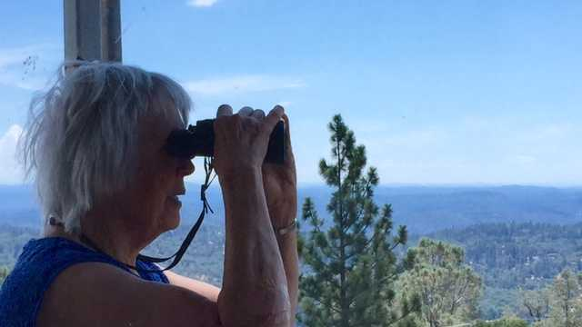 Volunteer lookout Judy Ten Ecyk keeps watch from a fire tower near Grass Valley.