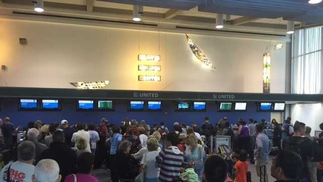 People are waiting in long lines at the United Airlines counter at Sacramento International Airport. (July 8, 2015)