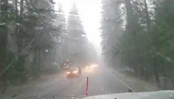 Tap or click here to listen to the hail pounding the windshield of this truck. Caltrans crews said they used plows to clear it from Highway 50.