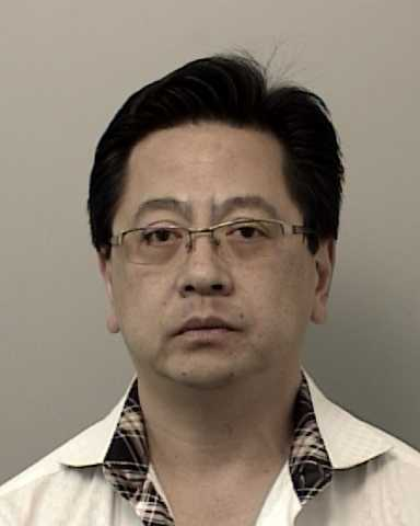 Andrew Lee was taken into custody on molesting and peeping charges, officers said.
