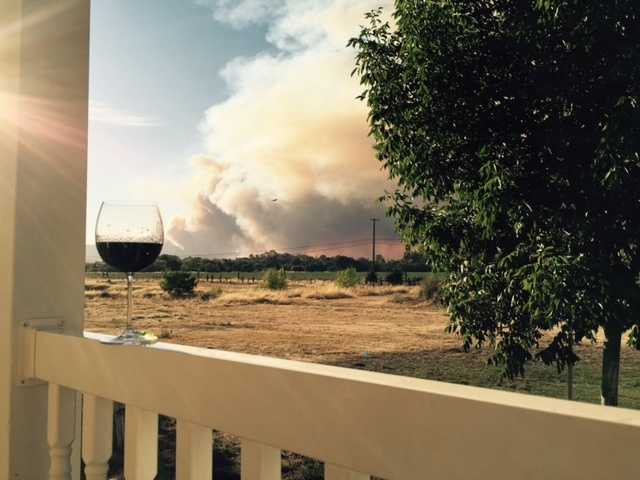 """A wind-fueled grass fire that broke out Wednesday near Lake Berryessa forced mandatory evacuations and caused a """"storm cloud of smoke"""" to cover parts of Yolo and Napa counties. (July 22, 2015)"""