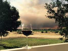 "A wind-fueled grass fire that broke out Wednesday near Lake Berryessa forced mandatory evacuations and caused a ""storm cloud of smoke"" to cover parts of Yolo and Napa counties. (July 22, 2015)"