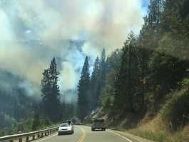 Highway 50 will remain closed overnight in both directions near Kyburz Drive because of a wildfire burning on both sides of the highway, officials said.