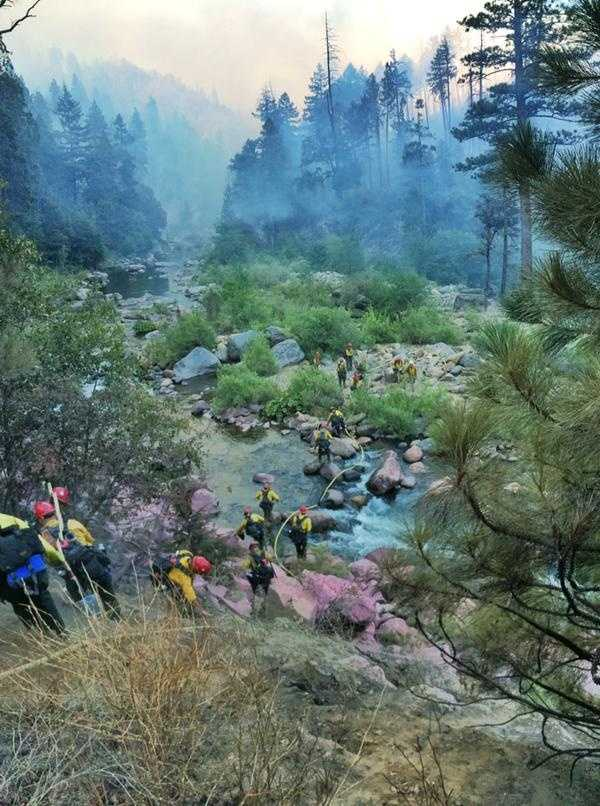 Firefighters battled steep terrain in El Dorado County to try and get to the flames burning in the trees and brush. (July 23, 2015)