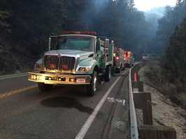 There is no work yet on when Highway 50 reopen. Fire trucks line the highway as crews climb the steep terrain.