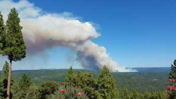 The explosive wildfire broke out Saturday afternoon near the Bear Creek River in Nevada County.
