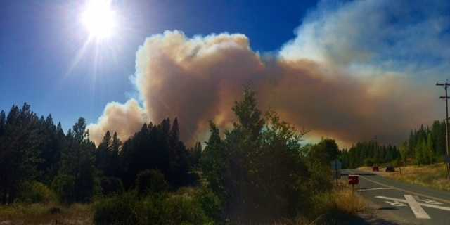 The so-called Lowell Fire burning in Nevada County grew to 1,500 acres and is threatening about 2,000 homes, according to Cal Fire. This photo was taken about 3 p.m. Saturday from the train tracks in Dutch Flat.