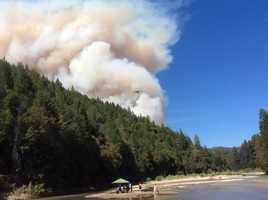 At Rollins Lake, beach-goers could see the large plume as airplanes circled the area.