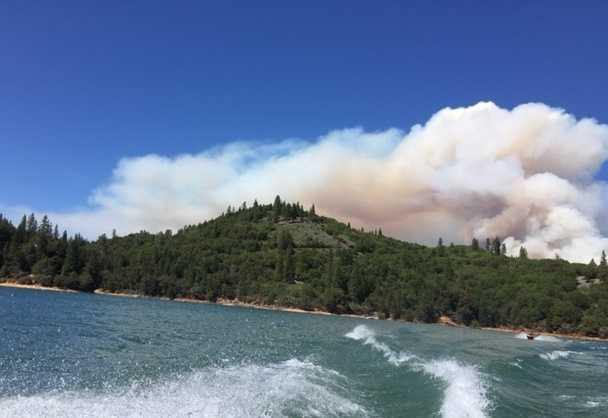 At nearby Rollins Lake, a huge ball of smoke rose from the hillsides.
