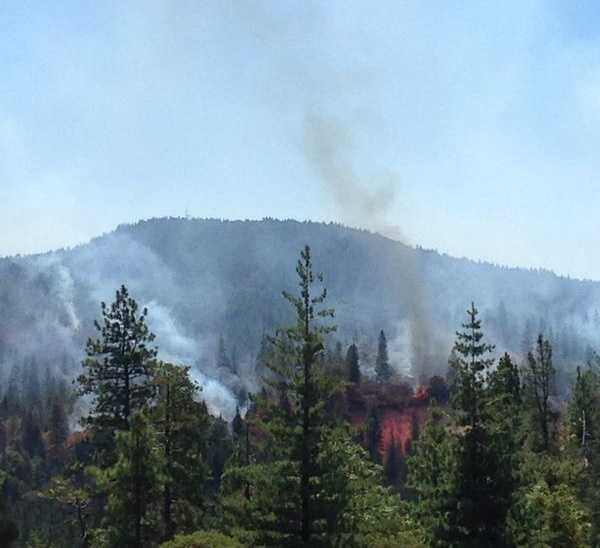 Flames could be seen Sunday shooting up from Lowell Fire in You Bet in Nevada County.