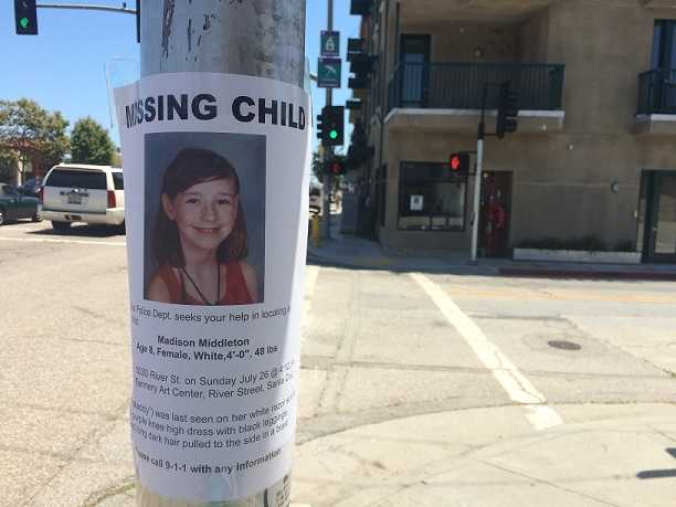 Flyers alert Santa Cruz residents that the girl is missing.