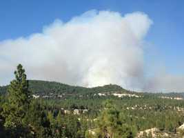 A large plume of smoke rose up from the so-called Lowell Fire, which burned in Nevada and Placer counties.