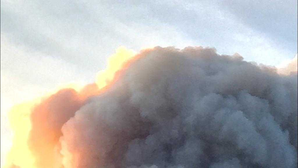 A KCRA viewer sent us this picture of a Cal Fire plane flying by a cloud of smoke from the Wragg Fire.