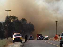 A wildfire that broke out in June near the town of Lotus forced the closure of Highway 49.