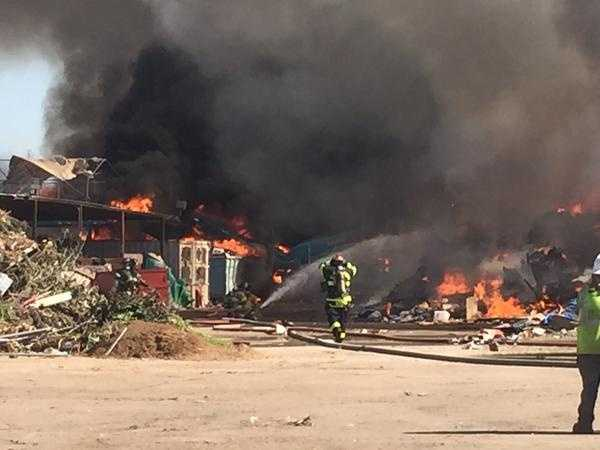 The three-alarm fire broke out about 4:20 p.m. at Sierra Waste.