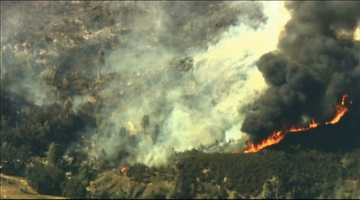Firefighters worked to try and contain a fast-moving wildfire in Lake County that prompted evacuations.