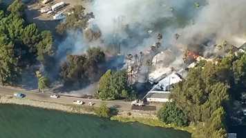 A three-alarm fire ripped through a mobile home park on Brannan Island, south of Isleton.