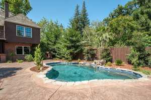 The massive grounds are complete with a custom pool, gated entry for driveway and two-car detached garage.