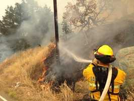 Firefighters dealt with triple-digit heat as the Rocky Fire burned in Lake, Yolo and Colusa counties.