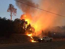 KCRA reporter Brian Hickey snapped this photo of flames from the Rocky Fire in Lake County as the early morning sky began to brighten up.