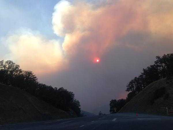 The sun was barely visible Monday evening through the dense smoke put out by the Rocky Fire. (Aug. 3, 2015)