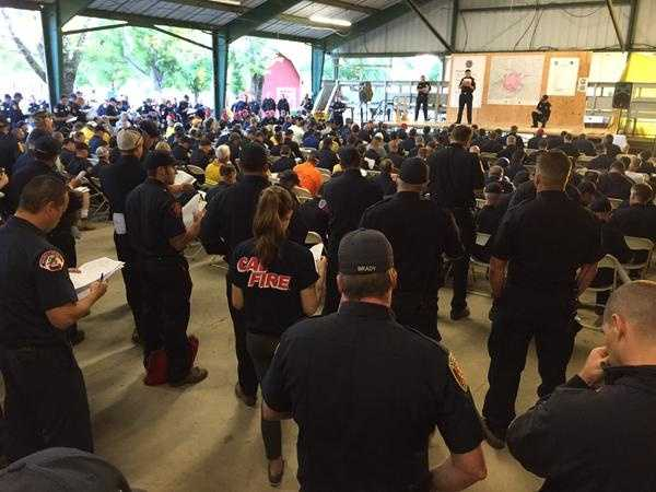 Firefighters from across the state listened in Monday to a morning briefing at the incident base in Lakeport. (Aug. 3, 2015)