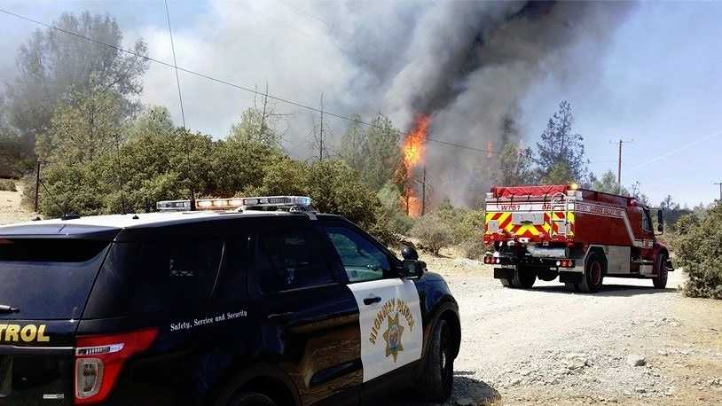At least one structure was destroyed in a fire that broke out in the Garden Valley area Monday. (Aug.17, 2015)