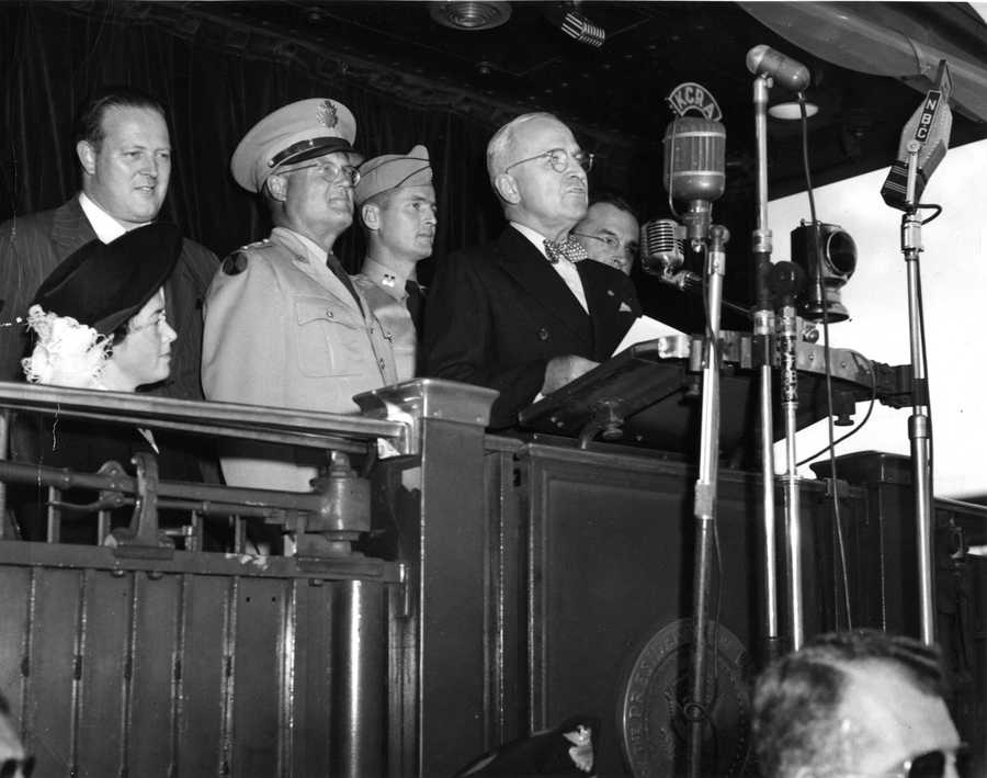 President Harry Truman speaking in front of media radio mics, including one from KCRA.