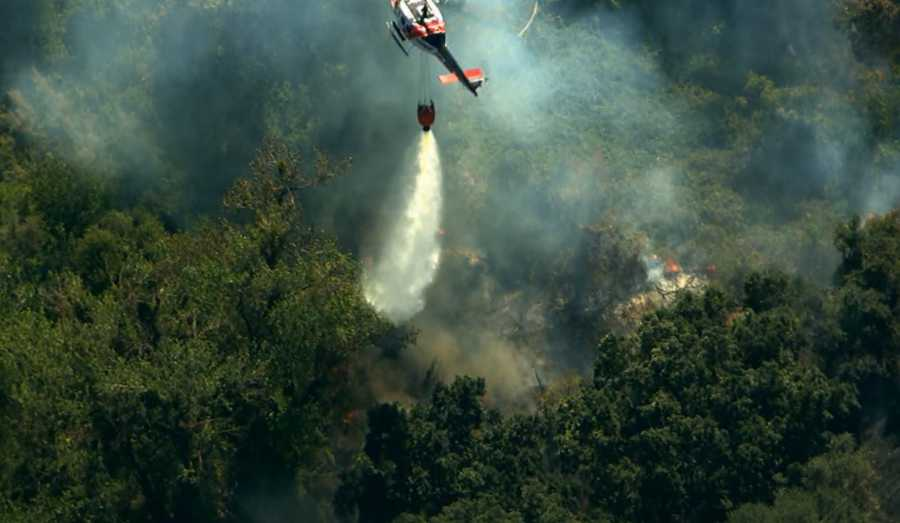 See images fromLiveCopter3 of fire crews battling a brush fire that crept close to homes near Oakdale.