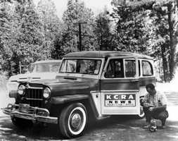 Sacramento's first television photographer Harry Sweet next to a KCRA news car.