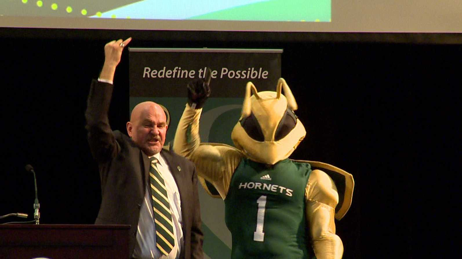 "The new president of Sacramento State University gives the college's ""stingers up"" salute following an address to the faculty on Thursday."