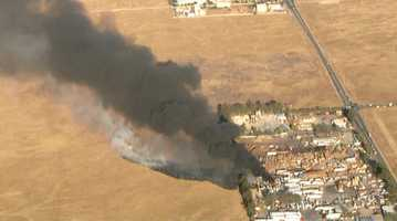 Fire crews are battling a large commercial fire that erupted at a commercial site in Lincoln.