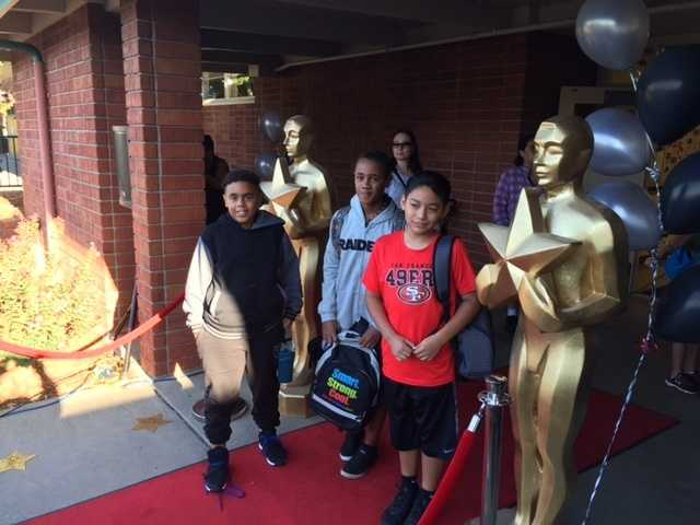 Life-size gold statuettes adorned the school's entrance as students were welcomed back to school. (Sept. 3, 2015)