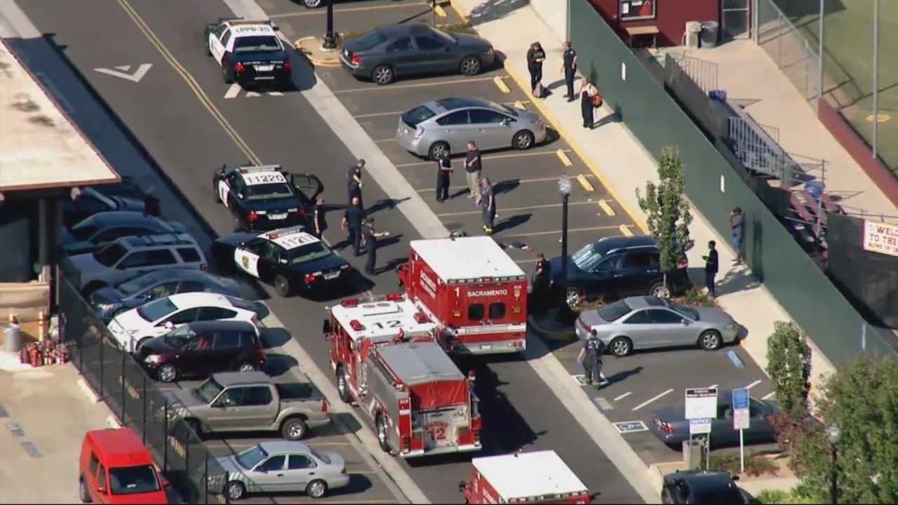 Police hunted for a gunman Thursday night who opened fire at a Sacramento college parking lot, killing one student and wounding two others, officials said.