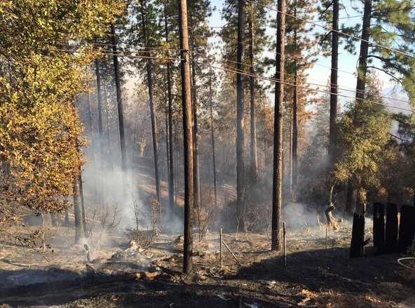 The Oak Fire burning near the town of Columbia in Tuolumne County scorched 100 acres and destroyed at least one home, according to Cal Fire. (Sept. 9, 2015)