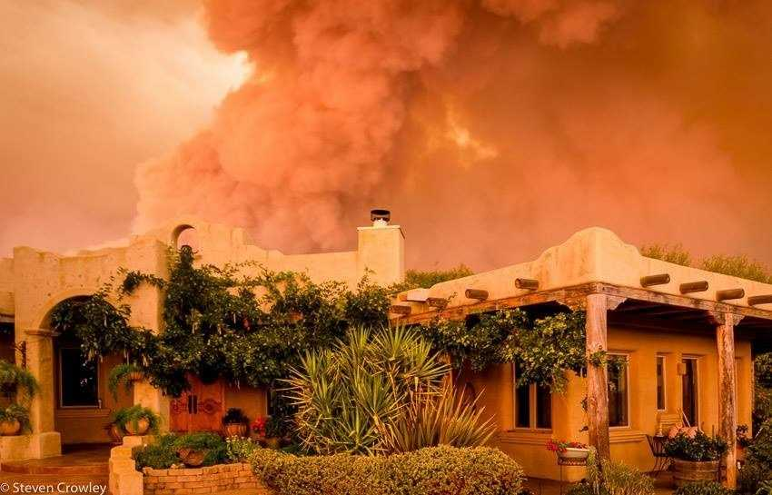 Above this house in San Andreas, a giant cloud of smoke fills the sky and blocks out the sun.