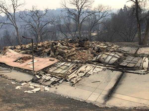 The Butte Fire ripped through this structure and left behind scorched trees and ground.