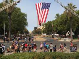 Thousands of people turned out on Sacramento's Capitol Mall to honor three men credited with thwarting a suspected terror attack on a Paris-bound train (Sept. 11, 2015)