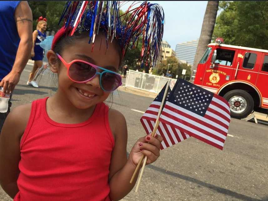 Seven-year-old Lexi missed school Friday for the parade and said she will write a report to share with her class. (Sept. 11, 2015)