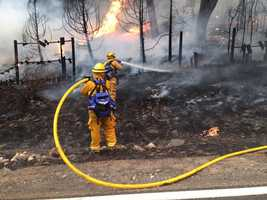Firefighters battle the Butte Fire along Mountain Ranch Road. (Sept. 11, 2015)