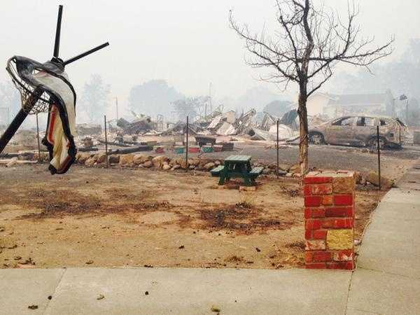 Perhaps hundreds of homes were destroyed by a wildfire in Lake County that raced through dry brush and exploded in size within hours, officials said.