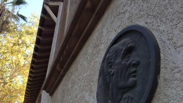 A plaque of Junipero Serra hangs outside Saint Francis of Assisi Catholic Church in Sacramento.