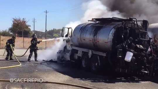 Sacramento Fire crews put out flames after an oil tanker caught fire Wednesday near Sutter's Landing Dog Park. (Sept. 23, 2015)