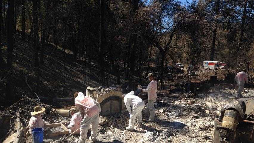 HazMat volunteer crews help Butte Fire victims sift through the remains of their homes on Wednesday.